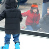Cousins Hudson Cross, 6, left, and Labhras Cross, 10, watch the skaters during the Peru Christkindlmarkt on Friday, November 29, 2019.<br /> Kelly Lafferty Gerber | Kokomo Tribune