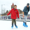 Xavier Higginbotham, 11, ice skates alongside Brad Hall at the Peru Christkindlmarkt on Friday, November 29, 2019.<br /> Kelly Lafferty Gerber | Kokomo Tribune