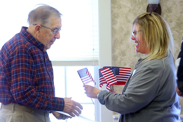 Veterans are recognized at Primrose Retirement Community of Kokomo during a ceremony on Nov. 7, 2019. Each veteran received a certificate, flag and flag pin in recognition of their service to our country from Primrose, Kindred Hospice, American Legion and VFW. Glen Grundman is handed a flag by Sherri Arthurhultz from Kindred Hospice.<br /> Tim Bath | Kokomo Tribune