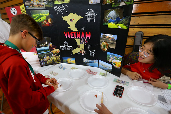 Kokomo High School student learn about culture and dance from around the world at the Culture Festival on Oct. 7, 2019. Caleb Taflinger plays a traditional Vietnamese game with guidance from Rose Tran.<br /> Tim Bath   Kokomo Tribune