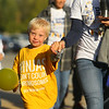 7-year-old Noah Conner walks the route around Western School Corporation during their first ever Buddy Walk for Down Syndrome on Saturday, Oct. 5. All proceeds from the event will go toward Project Playground, which aims to build an inclusive playground for special needs children and their peers.<br /> Kelly Lafferty Gerber | Kokomo Tribune