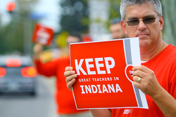 Kokomo School teacher Bill Evanich who teaches at the high school with fellow teachers  picketing in front the school administration building on south Washington during contract negotiations on Thursday Oct. 10, 2019. <br /> Tim Bath   Kokomo Tribune