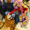 Ava Shanks, 5, dressed as a unicorn, pets Seger, dressed like a lion and certified therapy dog for both Community Howard and St. Vincent hospitals, as Seger's owner Cindie Hudson sits by his side during the Kids Community Halloween Party at the Kokomo Event Center on Saturday, October 26, 2019.<br /> Kelly Lafferty Gerber | Kokomo Tribune