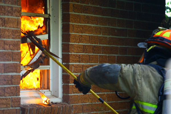 Firefighters battle a fire that was threw the roof when they arrived about 5:20 p.m. Friday Oct. 4, 2019, at 5263 East 300 South. Taylor Twp. Vol. Fire along with Greentown, Harrison Twp, Kempton and EMA volunteer departments assisted in battling the fire at Alice Tragesser's house. The fire resulted in a total loss but no one was injured.<br /> Tim Bath | Kokomo Tribune