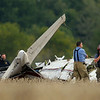 A single engine plane crashed killing the pilot bout a 1000 feet south of Indiana 22 between 300 and 400 East shortly after 5 p.m. Saturday Oct. 5, 2019. The aircraft reportedly departed Kokomo Airport about an hour previous but a witness said it was heading north. Howard County Coroner Steve Seele photographs the scene.<br /> Tim Bath | Kokomo Tribune