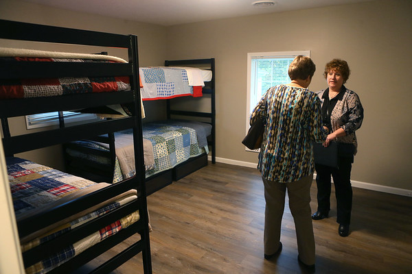 Attendees of Kokomo Rescue Mission's dedication of Watered Garden, its new women's shelter on 319 W. Taylor Street, check out the bedrooms upstairs on Wednesday, October 30, 2019. Each bed has a handmade quilt.<br /> Kelly Lafferty Gerber | Kokomo Tribune