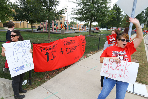 Kokomo Schoo teachers Alyson Hatcher-Kendal and Heather McAninch picket in front the school administration building on south Washington during contract negotiations on Thursday Oct. 10, 2019. <br /> Tim Bath | Kokomo Tribune