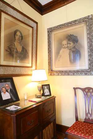 Portraits of Cole Porter's grandmother Rachel, left, and Cole Porter's mother Kate holding baby Cole are on the wall of Westleigh Farms in Peru, Indiana, on September 28, 2019.<br /> Kelly Lafferty Gerber | Kokomo Tribune