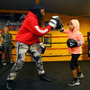 """Sieyumbe """"Coach Law"""" Arrington works with 9-year-old Faith Merriweather in the ring at IronFist Boxing Club on Wednesday, October 16, 2019.<br /> Kelly Lafferty Gerber 