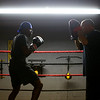 Jacques Stone, 17, left, practices skills in the ring with Dan Zimmerman at IronFist Boxing Club on Wednesday, October 16, 2019.<br /> Kelly Lafferty Gerber | Kokomo Tribune