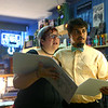 Joy Martin, left, and Chase Smith sing along to hymns during Beer and Hymns night at American Dream Hi Fi on Wednesday, October 9, 2019.<br /> Kelly Lafferty Gerber | Kokomo Tribune