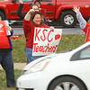 From left: Jessica DeFeo, a music teacher at Elwood Haynes and Boulevard Elementaries, Tina Hahn, a first grade teacher at Elwood Haynes Elementary, and Denise Groves, a teacher at Darrough Chapel Head Start cheer as cars passing by on South Washington honk their horns as Kokomo Teachers Association members and supporters rally outside of the Kokomo School Corporation Administrative Services Center during the second round of contract negotiations on Thursday, October 24, 2019.<br /> Kelly Lafferty Gerber | Kokomo Tribune