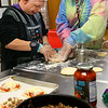 Kokomo Area Career Center students and Bona Vista consumers are partnering up to test food on Oct. 29, 2019, for the bona vista dance on Nov. 15. Matt Rubow is helped by Maddison Parks making mini pizzas.<br /> Tim Bath | Kokomo Tribune