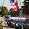 """A procession of law enforcement make their way through Russiaville under the Garrison flag to Russiaville Cemetery, where Indiana State Trooper Peter """"Bo"""" Stephan was laid to rest on Friday, October 18, 2019. Stephan died Oct. 11 in a car crash on Old Indiana 25 southwest of Americus. He was responding to a call when he lost control of his car.<br /> Kelly Lafferty Gerber 