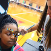 Kokomo High School student learn about culture and dance from around the world at the Culture Festival on Oct. 7, 2019. Aniya Edwards from Central Middle school gets her face painted by Regan Kimbler. This type of painting is popular in the Bahamas.<br /> Tim Bath | Kokomo Tribune