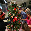 Taylored PC ladies decorate their tree at the We Care Trim-A-Tree setup at Markland Mall on Sunday Oct. 27, 2019. They are Kayla Floyd, Patty Buckwalter, Karen Burns, Konnie Conwell and Katie Taylor who were all having a good time.<br /> Tim Bath | Kokomo Tribune