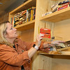 Jennifer Marden, the owner of Chapter 2 Books, a used bookstore at 107 E. Sycamore in downtown Kokomo, organizes and shelves books on Tuesday, October 22, 2019, in preparation for opening day.<br /> Kelly Lafferty Gerber | Kokomo Tribune