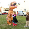 7-year-old Levi Stafford, dressed like a dinosaur, playfully chases kids during First Friday on Oct. 4, 2019. Stafford's costume was a popular hit with the kids during October's Masquerade theme.<br /> Kelly Lafferty Gerber | Kokomo Tribune