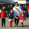 Holding hands from left: 8-year-old Rex Redding, 4-year-old Twyla Breisch, and 4-year-old Jillian Maple walk together with Lee Ann Redding behind them during Western School Corporation's first ever Buddy Walk for Down Syndrome on Saturday, Oct. 5. All proceeds from the event will go toward Project Playground, which aims to build an inclusive playground for special needs children and their peers.<br /> Kelly Lafferty Gerber | Kokomo Tribune