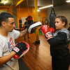 Luis Moreno, works with 16-year-old Shae Martin at IronFist Boxing Club on Wednesday, October 16, 2019.<br /> Kelly Lafferty Gerber | Kokomo Tribune