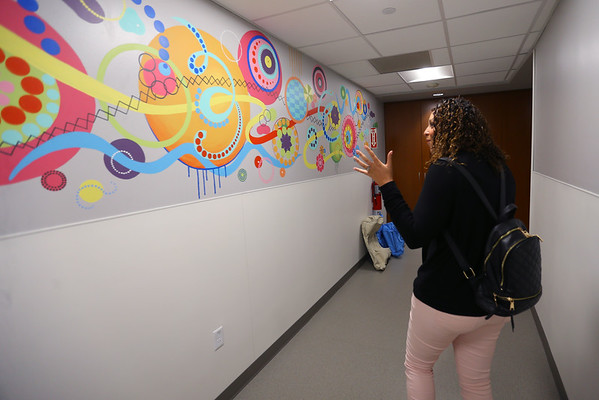 Cindy Hendrix in the St. Vincent Cancer Center on Oct. 9, 2019. The colorfully decorated entryway into the newest addition to the treatment facility is where Cindy spent 28 days getting radiation treatments.<br /> Tim Bath   Kokomo Tribune