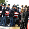 """Law enforcement carries the casket of Indiana State Trooper Peter """"Bo"""" Stephan, who was laid to rest at Russiaville Cemetery on Friday, October 18, 2019. Stephan died Oct. 11 in a car crash on Old Indiana 25 southwest of Americus. He was responding to a call when he lost control of his car.<br /> Kelly Lafferty Gerber 