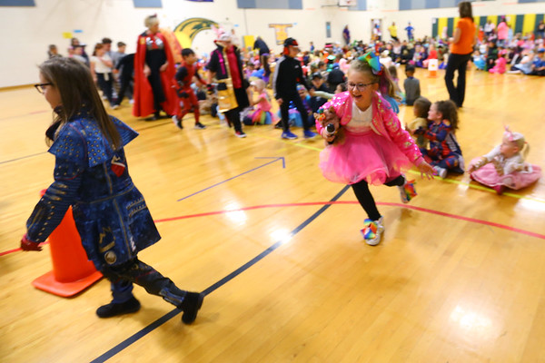 Eastern Elementary School students parade through the halls in front of each other and their parents dressed in Halloween costumes on Oct. 31, 2019. Tim Bath | Kokomo Tribune