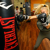 Anni Ellis, 16, warms up with the punching bag at IronFist Boxing Club on Wednesday, October 16, 2019.<br /> Kelly Lafferty Gerber | Kokomo Tribune