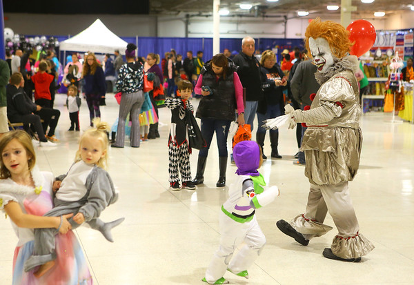 Pennywise, the clown from It, waves at Buzz Lightyear from Toy Story during the Kids Community Halloween Party at the Kokomo Event Center on Saturday, October 26, 2019.<br /> Kelly Lafferty Gerber | Kokomo Tribune