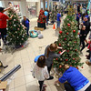 Student from Sts. Joan of Arc and Patrick School(right) decorate their tree at the We Care Trim-A-Tree setup at Markland Mall on Sunday Oct. 27, 2019.<br /> Tim Bath | Kokomo Tribune