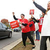 KyAnne Shedron, left, a preschool teacher at Pettit Park Elementary, cheers alongside Diana Heard, a special education teacher at Pettit Park, and Mona Evoy, right, a second grade teacher at Pettit Park. Kokomo Teachers Association members and supporters rallied outside of the Kokomo School Corporation Administrative Services Center during the second round of contract negotiations on Thursday, October 24, 2019.<br /> Kelly Lafferty Gerber | Kokomo Tribune