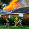 Firefighters battle a fire that was threw the roof when they arrived about 5:20 p.m. Friday Oct. 4, 2019, at 5263 East 300 South. Taylor Twp. Vol. Fire along with Greentown, Harrison Twp, Kempton and EMA volunteer departments assisted in battling the fire at Alice Tragesser's house. The fire resulted in a total loss but no one was injured.<br /> Tim Bath   Kokomo Tribune
