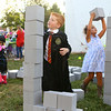Jeremy Culp, 5, dressed as Ron Weasley, stacks blocks provided by AndyMark as high as he can reach during First Friday, Oct. 4, 2019.<br /> Kelly Lafferty Gerber | Kokomo Tribune