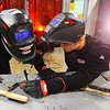 Graham Stoll and Carter Little work together to chip away the slag and critique each other on their welding bead during welding class at Maconaquah High School on Oct. 24, 2019.<br /> Tim Bath | Kokomo Tribune