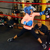 9-year-old Faith Merriweather, left, boxes against 8-year-old Joshua Merriweather during a bout at IronFist Boxing Club on Wednesday, October 16, 2019.<br /> Kelly Lafferty Gerber | Kokomo Tribune