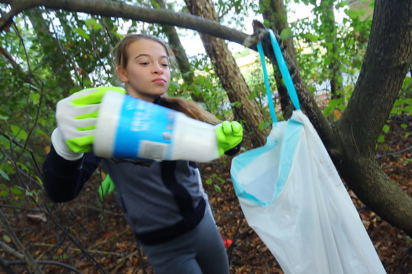 Tri-Central 8th graders spent the morning cleaning up the nature trail on the west part of the school property on Sept. 27, 2019. Kady Graves picks up trash that has blown into the woods.<br /> Tim Bath | Kokomo Tribune