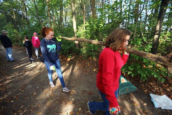 Tri-Central 8th graders spent the morning cleaning up the nature trail on the west part of the school property on Sept. 27, 2019. Emma Conrad and Katie Young carry a dead tree that has fallen across the path to a burn pile.<br /> Tim Bath | Kokomo Tribune