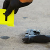 Five people have been arrested after a shootout and high speed chase on Monday evening September 2, 2019. A red Ford F150 truck was finally stopped in the 600 block of south Jay where 3 were detained. Later one in the 800 block of East King and finally the 5th at Vaile and Ohio. Three guns and a bag of drug were also recovered at 3 different locations. Detective Mike Banush bags up one of the guns recovered at KFC on Reed Road.<br /> Tim Bath | Kokomo Tribune