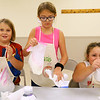 Hazel Bandelier, Gracie Shade, and Jordyn Rezabek  mix their ice cream at Pint Size Chef. It's a program for children ages 6-12 learn the basics of cooking such as reading a recipe, the different cooking tools, measuring different food as well as proper etiquette and they will also prepare a fun and simple dish each week. This Tuesday on Sept. 17, 2019, the kids were making bagel pizza and ice cream in a bag.<br /> Tim Bath | Kokomo Tribune