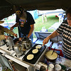 Army veterans Hughie Roberts from Fenwick, Michigan, and Steven Jensen and his wife Jo from Sleepy Eye, Minnesota, along with an army of volunteers cook for about a hundred people for each meal all week at the Vietnam Veterans Reunion on Saturday morning Sept. 21, 2019.<br /> Tim Bath | Kokomo Tribune