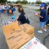 Food Finders, United Way and UAW 292 teamed up to get a food truck for striking GM workers on Sept. 27, 2019. Food Finders, United Way and UAW 292 teamed up to get a food truck for striking GM workers on Sept. 27, 2019. Volunteers set up the food line to give out food to fellow UAW 292 members in the parking lot of North Central Outdoor Power.<br /> Tim Bath | Kokomo Tribune