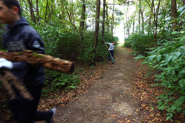 Tri-Central 8th graders spent the morning cleaning up the nature trail on the west part of the school property on Sept. 27, 2019. Noah Bllard rakes leaves and sticks off one of the paths.<br /> Tim Bath | Kokomo Tribune