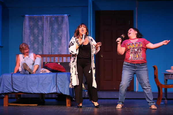 Mamma Mia! being performed by Kokomo Civic Theatre at IUK's Havens Auditorium on Sept. 20-22. Dress rehearsal on Sept. 16, 2019. Donna(Beth Metcalf) is cheered up by her best friends Tonya(Claire Cooper) and Rosie(Peggy Frye).<br /> Tim Bath | Kokomo Tribune
