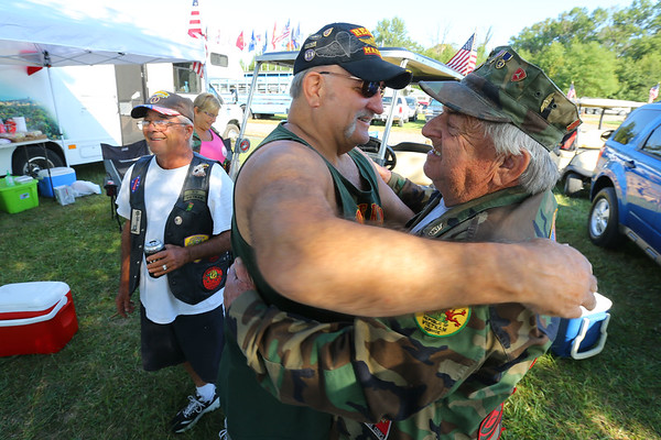 Marines Dave Baumann from Menitowoc, Wisconsin and Roland Justice from Cloverdale, Indiana hug at the annual Vietnam Veterans Reunion on Sept. 19, 2019.<br /> Tim Bath | Kokomo Tribune
