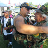 Marines Dave Baumann from Menitowoc, Wisconsin and Roland Justice from Cloverdale, Indiana hug at the annual Vietnam Veterans Reunion on Sept. 19, 2019.<br /> Tim Bath   Kokomo Tribune