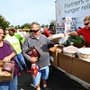 Food Finders, United Way and UAW 292 teamed up to get a food truck for striking GM workers on Sept. 27, 2019. Shannon West and husband Bruce West, who is a GM worker picking up food in the parking lot of North Central Outdoor Power.<br /> Tim Bath | Kokomo Tribune