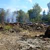 A trash fire on Tipton County property continues to burn on the edge of Kempton on Sept. 18, 2019.<br /> Tim Bath   Kokomo Tribune