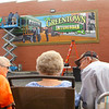 Spectators watch as mural designers and artists Michael Clark, from Aledo, Illinois, and Scott Lindley, from Mount Pulaski, Illinois, install the final piece of Greentown's Interurban mural on the side of Main Occasions Catering on Saturday, September 28, 2019.<br /> Kelly Lafferty Gerber | Kokomo Tribune