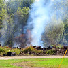 A trash fire on Tipton County property continues to burn on the edge of Kempton on Sept. 18, 2019.<br /> Tim Bath | Kokomo Tribune