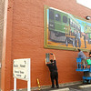 Russell Stier, left, installs the sponsorship sign while Scott Lindley and Kain Perkins put the final touches on Greentown's Interurban mural on the side of Main Occasions Catering on Saturday, September 28, 2019.<br /> Kelly Lafferty Gerber | Kokomo Tribune